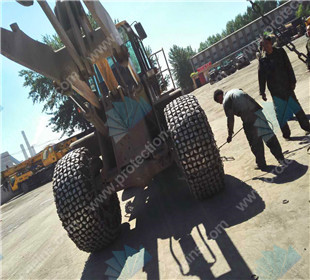 14.00-24 tire chains used on wheel loader working at open pit for sale
