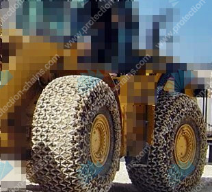 23.5-25 tyre protection chains on a CAT working at a limestone quarry